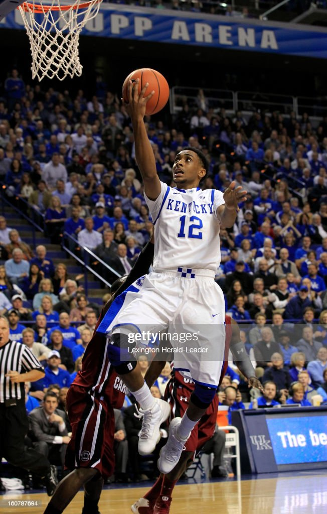 Kentucky Wildcats guard Ryan Harrow (12) scores on a drive against South Carolina at Rupp Arena in Lexington, Kentucky, Tuesday, February 05, 2013.