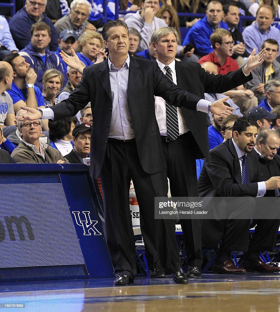 Kentucky Wildcats head coach John Calipari and assistant coach John Robic question a first-half call during an NCAA basketball game against South Carolina at Rupp Arena in Lexington, Kentucky, Tuesday, February 05, 2013.