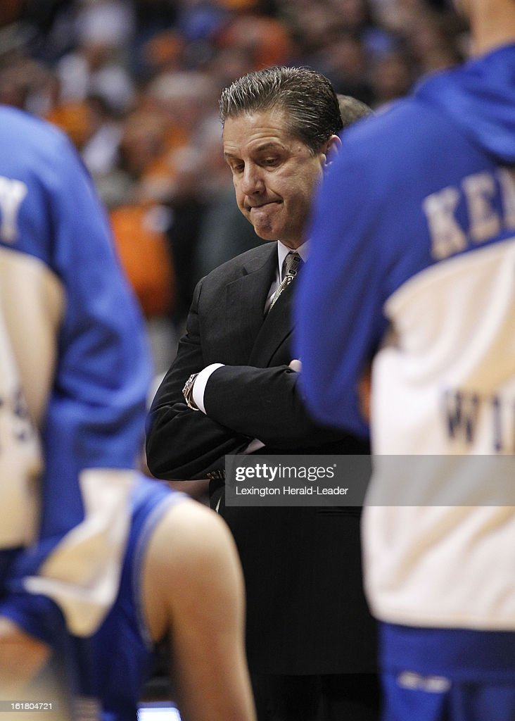 Kentucky Wildcats head coach John Calipari appears quiet in the huddle waiting for the officials to sort out the double technical during the game against Tennessee at Thompson-Boling Arena in Knoxville, Tennessee, Saturday, February 16, 2013. Tennessee defeated Kentucky, 88-58.