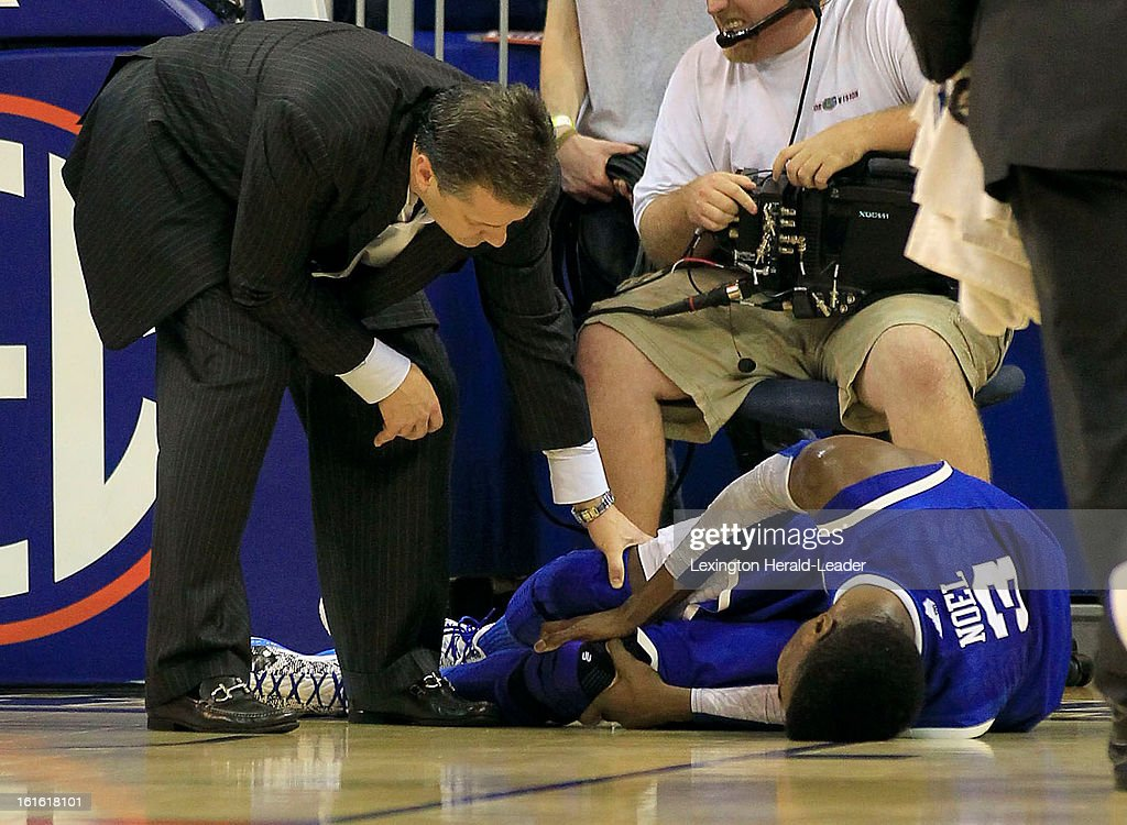 Kentucky Wildcats head coach John Calipari asses Kentucky Wildcats forward Nerlens Noel (3) after he was injured during the second half against Florida at the O'Connell Center in Gainesville, Florida, Tuesday, February 12, 2013. Florida defeated UK 69-52.