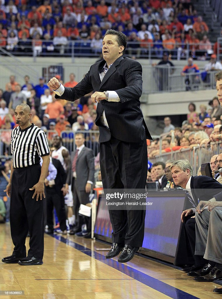 Kentucky Wildcats head coach John Calipari gets air after a 'no-call' in the second half against Florida at the O'Connell Center in Gainesville, Florida, Tuesday, February 12, 2013. Florida defeated UK