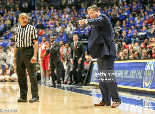 Kentucky Wildcats head coach John Calipari reacts to a play and lets the official know about it during the first semi final game in the Southeastern...