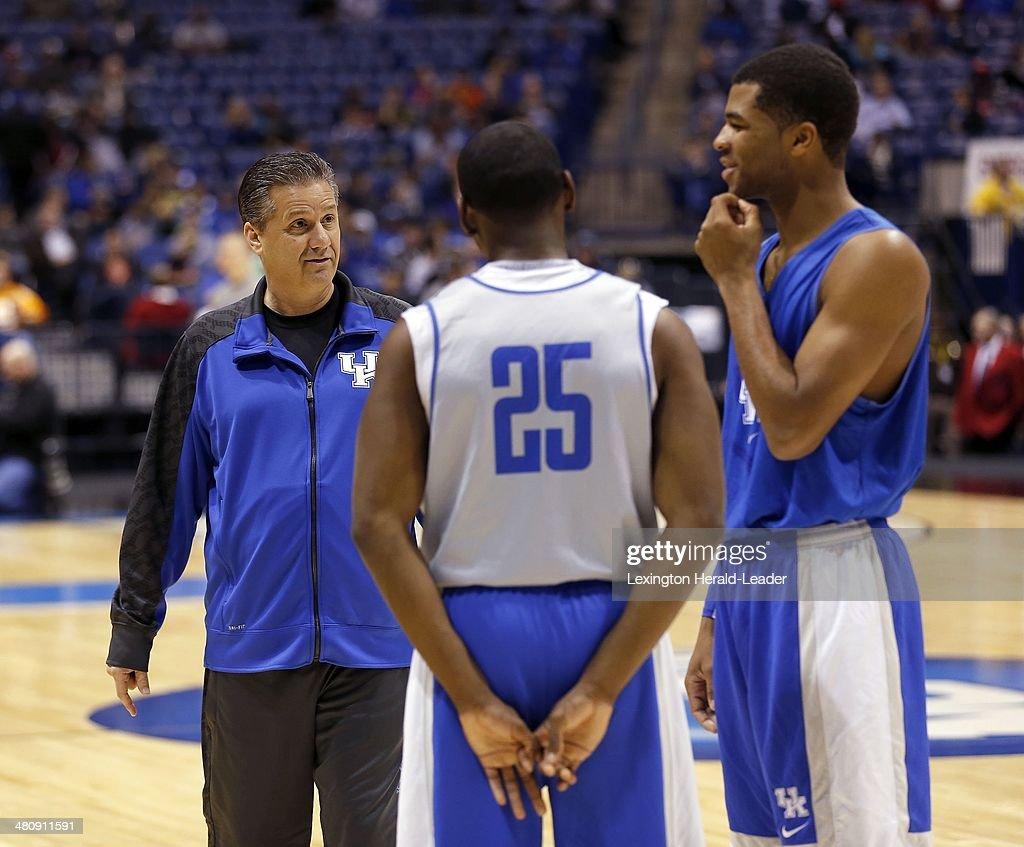 Kentucky Wildcats head coach John Calipari talks to guard Dominique Hawkins and Kentucky guard Aaron Harrison as Kentucky practiced at Lucas Oil...