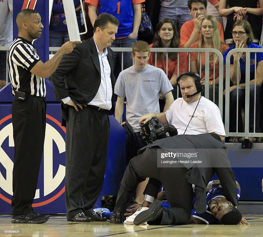 Kentucky Wildcats head coach John Calipari watches as Kentucky Wildcats forward Nerlens Noel (3) is treated after being injured during the second half against Florida at the O'Connell Center in Gainesville, Florida, Tuesday, February 12, 2013. Florida defeated UK