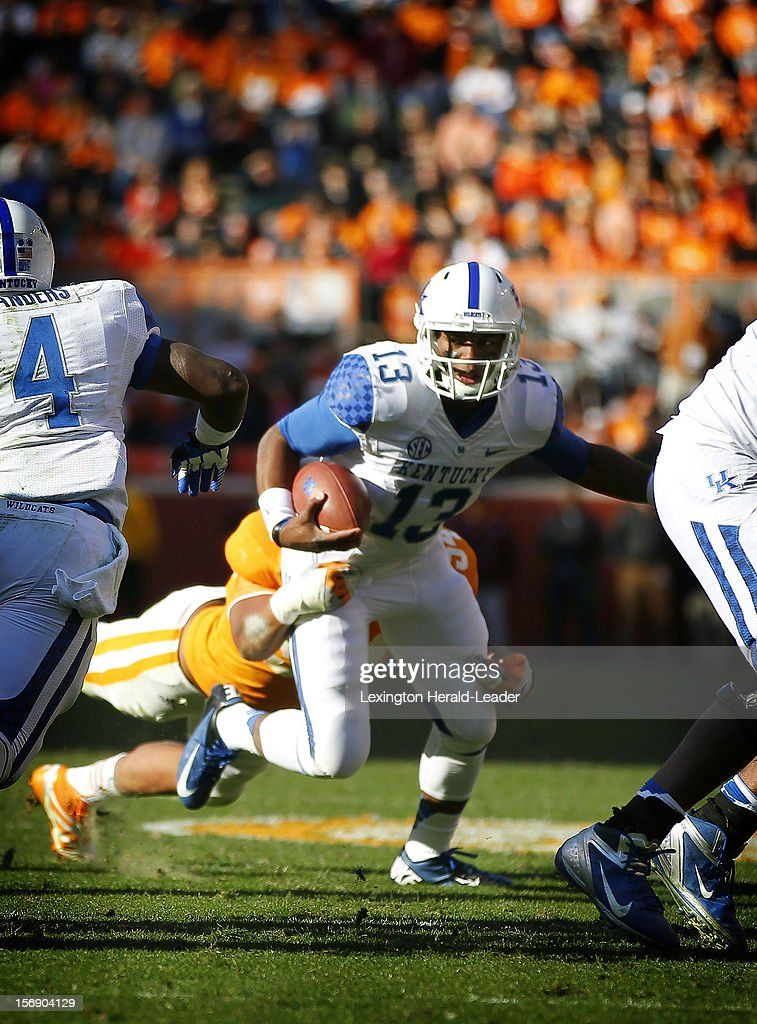 Kentucky Wildcats quarterback Jalen Whitlow (13) is sacked for the fourth time in the third quarter at Neyland Stadium on Saturday November 24, 2012, in Knoxville, Tennessee. The Tennessee Volunteers defeated the Kentucky Wildcats, 37-17.