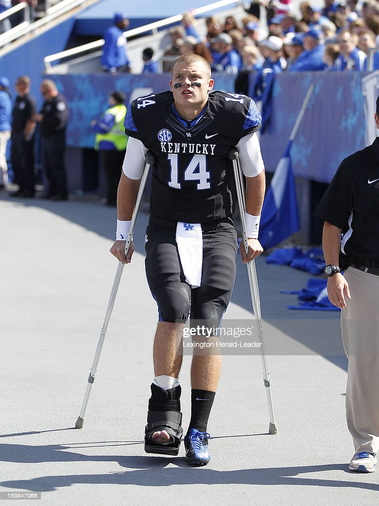 Kentucky Wildcats quarterback Patrick Towles (14) walks on crutches after halftime in the game against Mississippi State at Commonwealth Stadium in Lexington, Kentucky, Saturday, October 6, 2012. Mississippi State defeated Kentucky, 27-14.