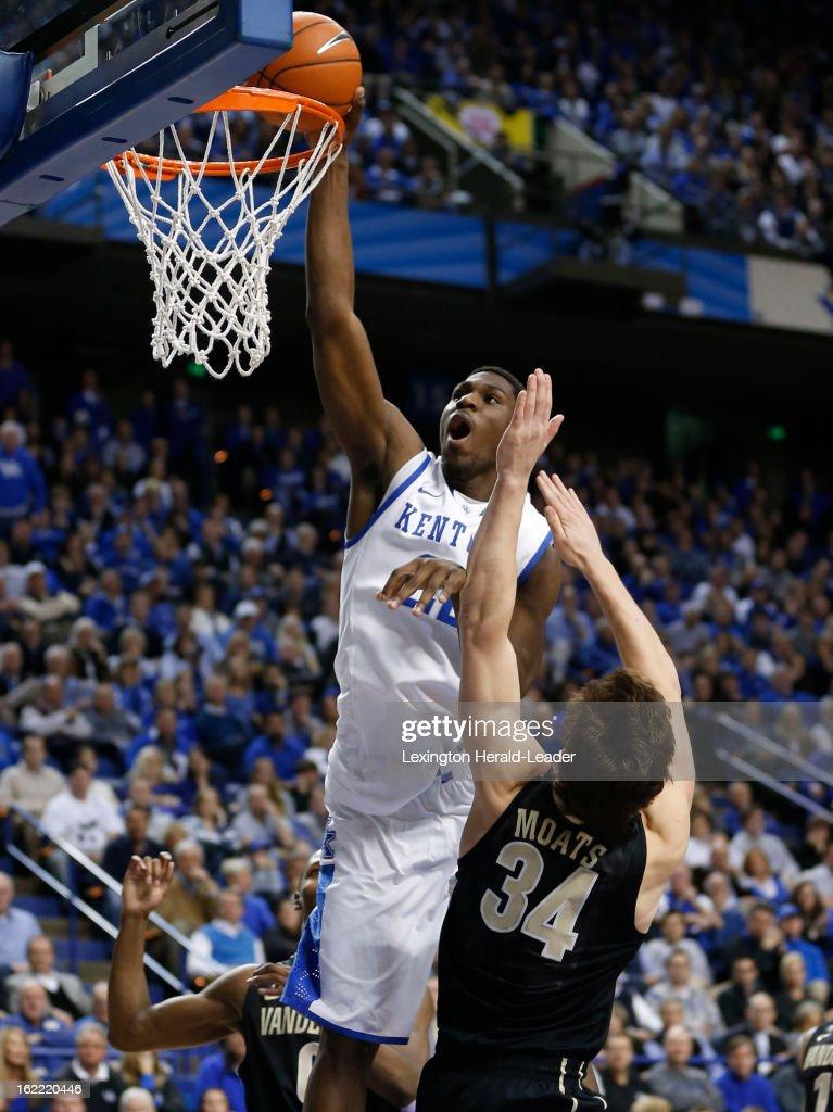 Kentucky's Alex Poythress (22) dunks over Vanderbilt's Shelby Moats (34) as Kentucky defeated Vanderbilt, 74-70, on Wednesday, February 20, 2013, at Rupp Arena in Lexington, Kentucky.