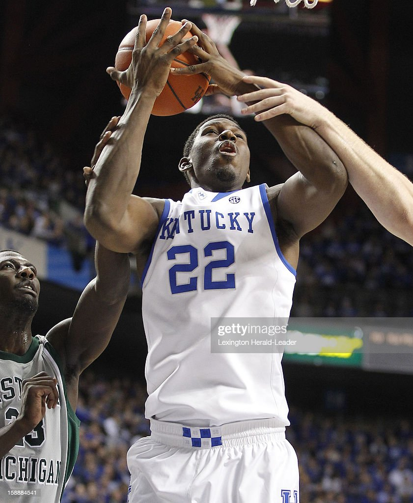 Kentucky's Alex Poythress (22) fends off Eastern Michigan defenders to convert a shot in the pain at Rupp Arena in Lexington, Kentucky, on Wednesday, January 2, 2013. Kentucky routed the visiting Eagles, 90-38.