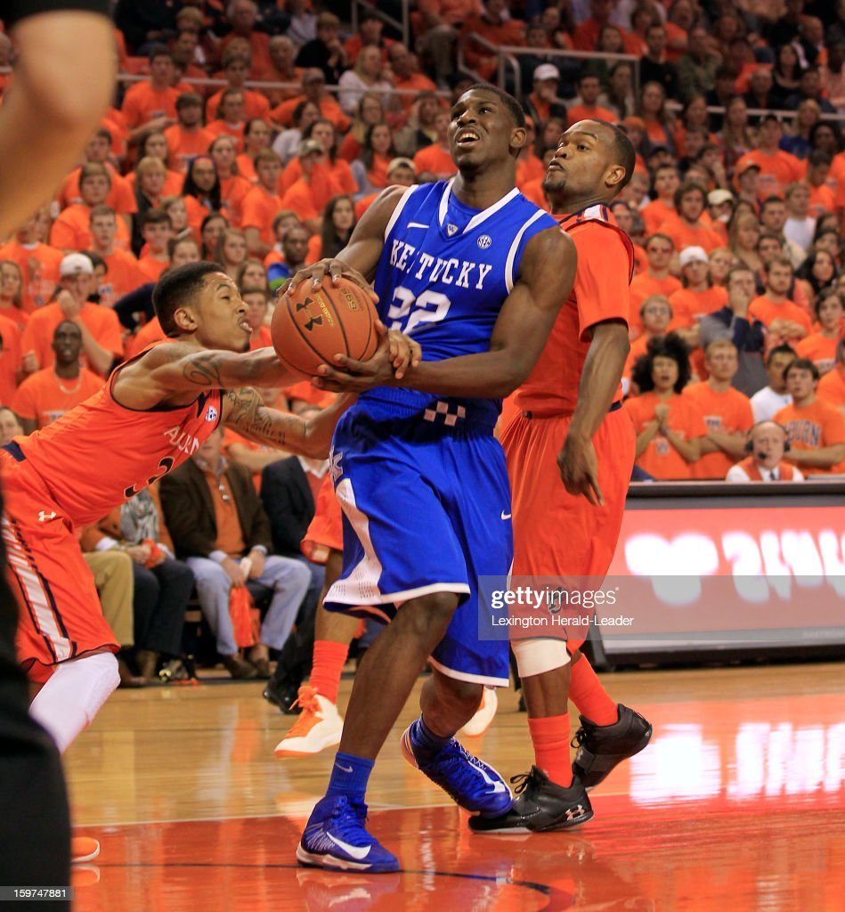 Kentucky's Alex Poythress (22) is fouled by Auburn's Chris Denson at Auburn Arena in Auburn, Alabama, on Saturday, January 19, 2013. Kentucky won, 75-53.