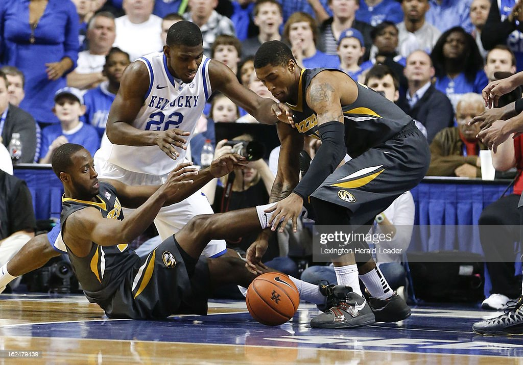 Kentucky's Alex Poythress (22) went between two Missouri players for a loose ball at Rupp Arena in Lexington, Kentucky, Saturday, February 23, 2013. Kentucky topped Missouri, 90-83.