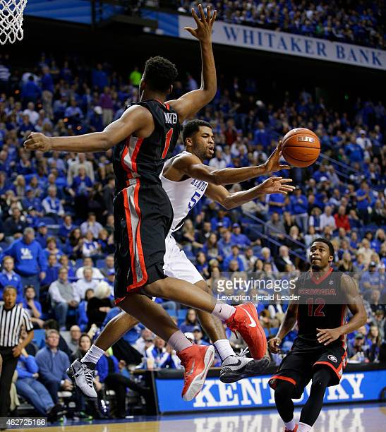 Kentucky's Andrew Harrison dishes out to the wing under pressure from Georgia's Yante Maten at Rupp Arena in Lexington Ky on Tuesday Feb 3 2015...