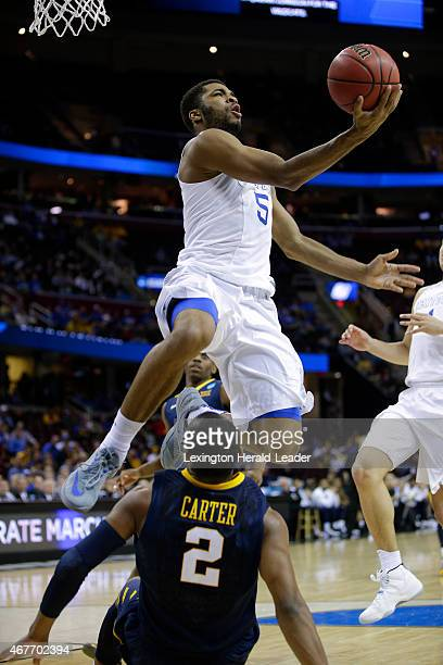 Kentucky's Andrew Harrison scores a circus basket with the foul on West Virginia's Jevon Carter in the second half of the NCAA Tournament Sweet 16...