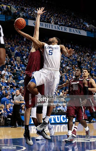 Kentucky's Andrew Harrison scores against South Carolina's Laimonas Chatkevicius in the second half at Rupp Arena in Lexington Ky on Saturday Feb 14...