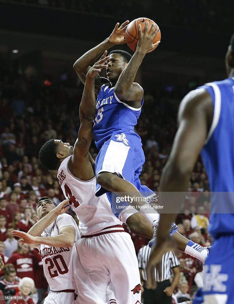 Kentucky's Archie Goodwin (10) was fouled by Arkansas Razorbacks forward Coty Clarke (4) at Bud Walton Arena in Fayetteville, Arkansas, on Saturday, March 2, 2013. Arkansas prevailed, 73-60.