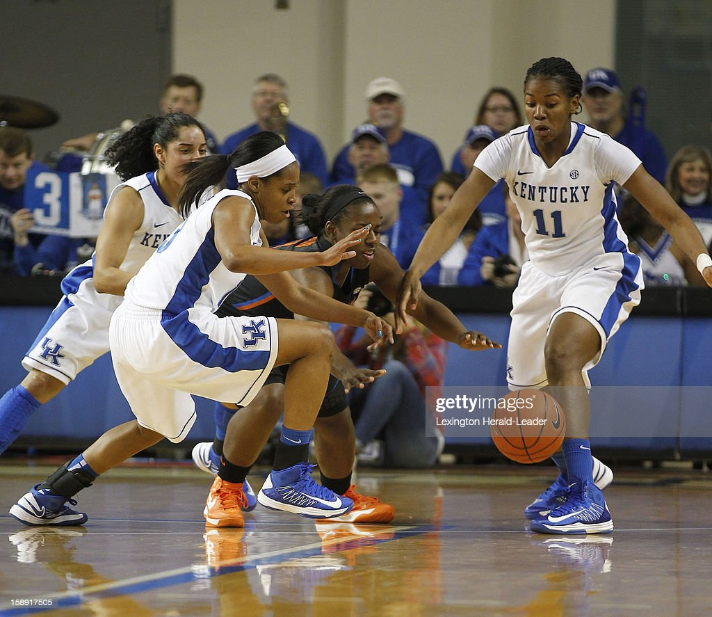 Kentucky's Bria Goss (13) steals the ball from Florida's January Miller as Kentucky's Jennifer O'Neill (0) and DeNesha Stallworth (11) apply pressure at Memorial Coliseum in Lexington, Kentucky, on Thursday, January 3, 2013.