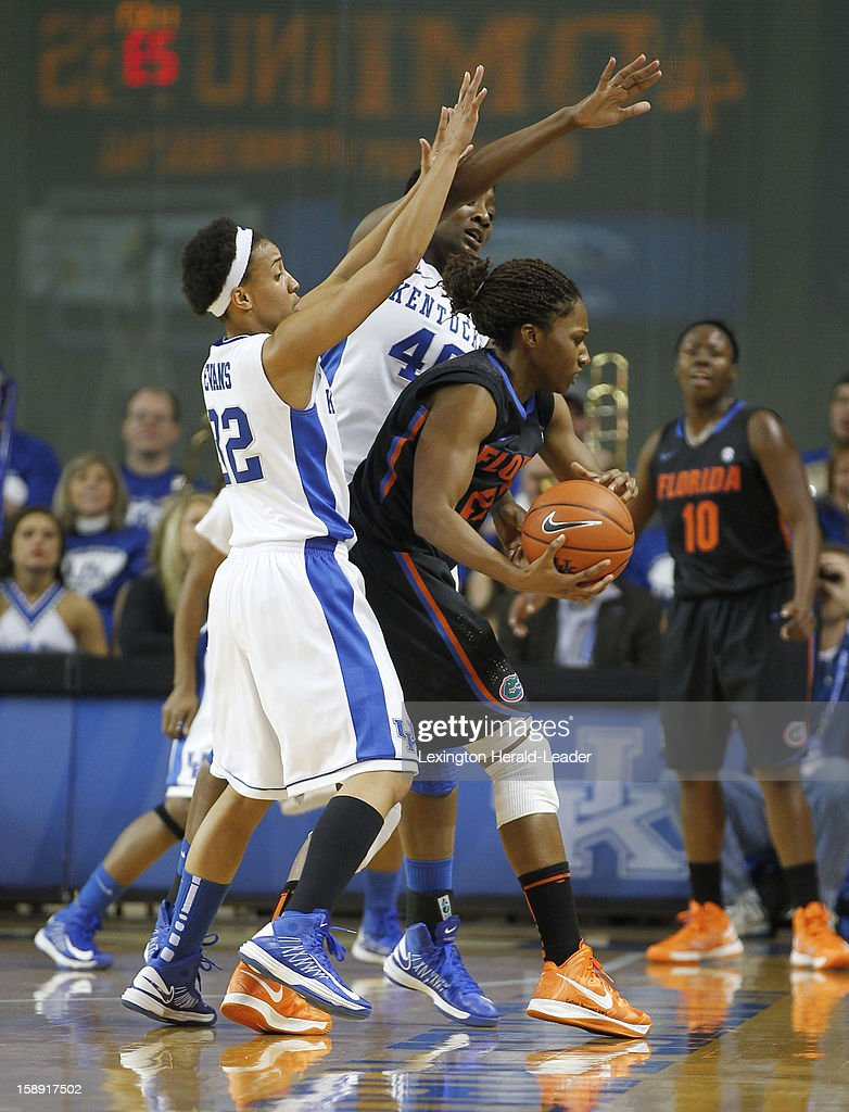 Kentucky's Brittany Henderson (40) and Kastine Evans (32) pressure Florida's Kayla Lewis at Memorial Coliseum in Lexington, Kentucky, on Thursday, January 3, 2013.