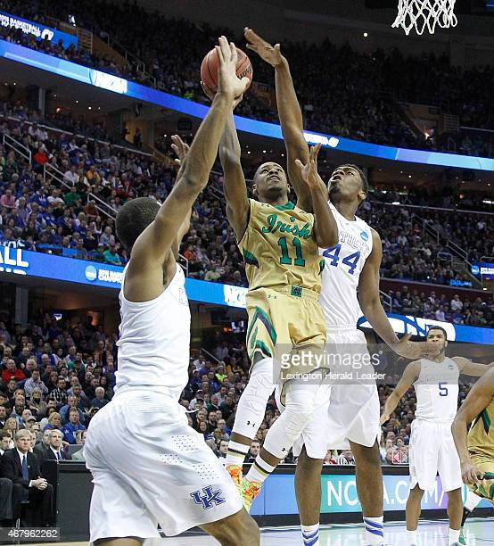 Kentucky's Dakari Johnson blocks the shot of Notre Dame's Demetrius Jackson during the first half in the NCAA Tournament's Elite 8 on Saturday March...