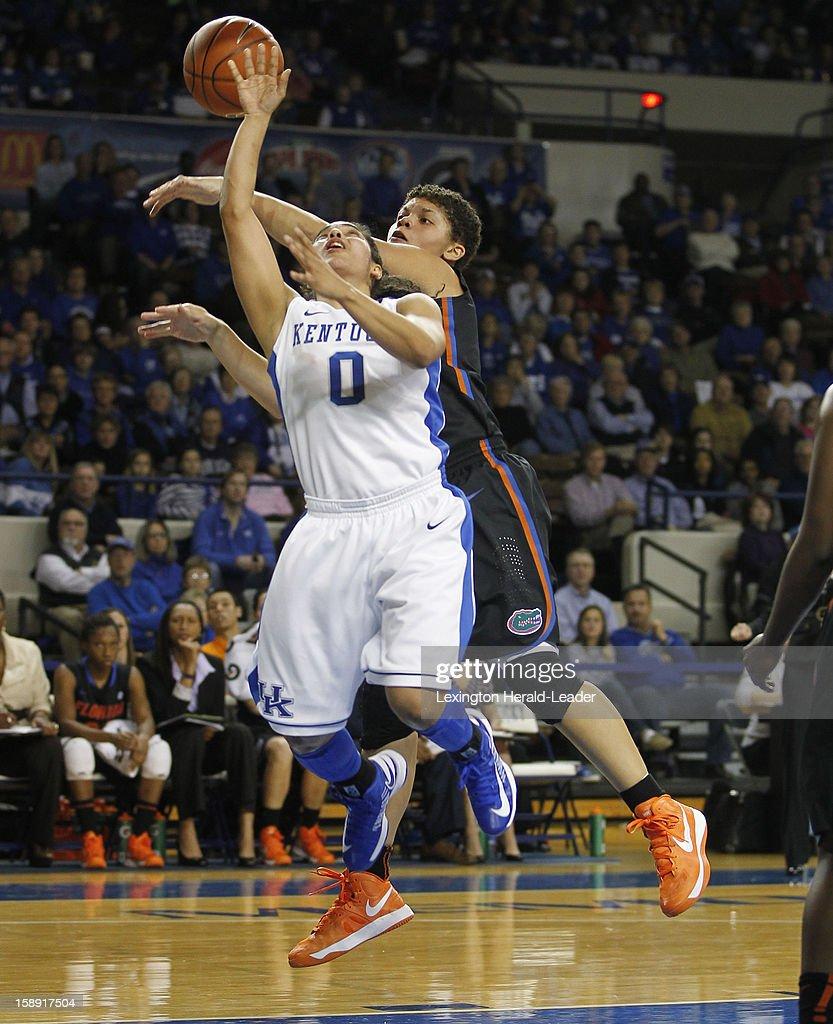 Kentucky's Jennifer O'Neill (0) is fouled by Florida's Sydney Moss at Memorial Coliseum in Lexington, Kentucky, on Thursday, January 3, 2013.