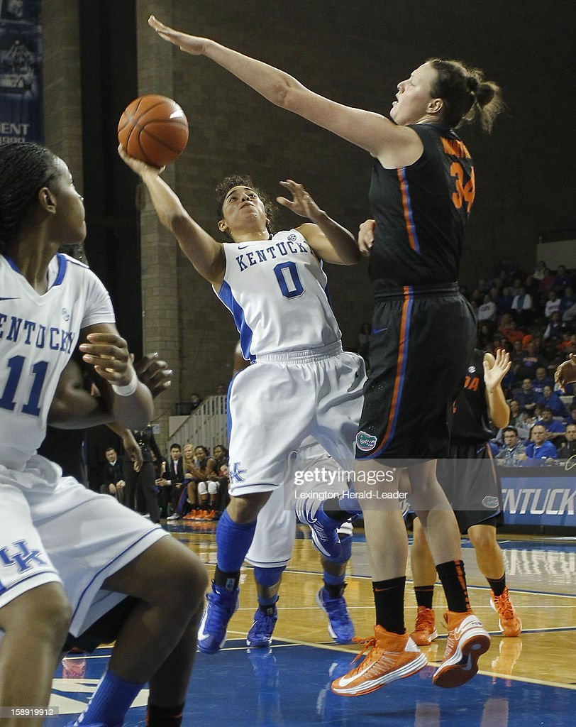 Kentucky's Jennifer O'Neill (0) rives against Florida's Vicky McIntyre (34) at Memorial Coliseum in Lexington, Kentucky, on Thursday, January 3, 2013. The host Wildcats won, 76-69.