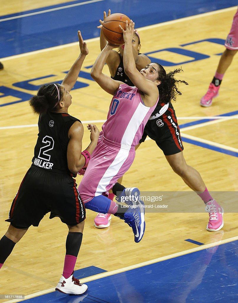 Kentucky's Jennifer O'Neill (0) slices around South Carolina's Shelbretta Ball (2) for a basket at Memorial Coliseum in Lexington, Kentucky, on Thursday, February 14, 2013. Kentucky defeated South Carolina, 78-74.
