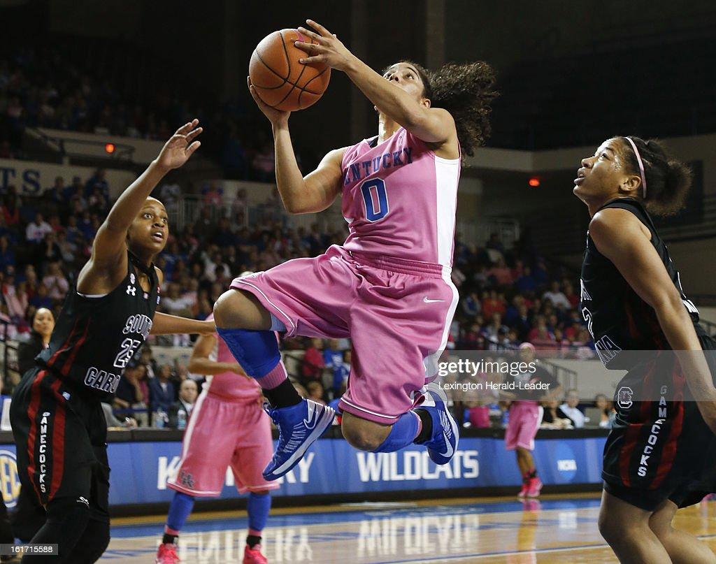 Kentucky's Jennifer O'Neill (0) splits two South Carolina defenders on the way to a layup at Memorial Coliseum in Lexington, Kentucky, on Thursday, February 14, 2013.