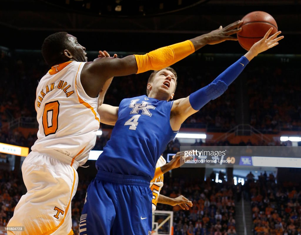 Kentucky's Jon Hood, has his shot blocked by Tennessee Volunteers center Yemi Makanjuola (0) during action at Thompson-Boling Arena in Knoxville, Tennessee, Saturday, February 16, 2013. Tennessee defeated Kentucky, 88-58.
