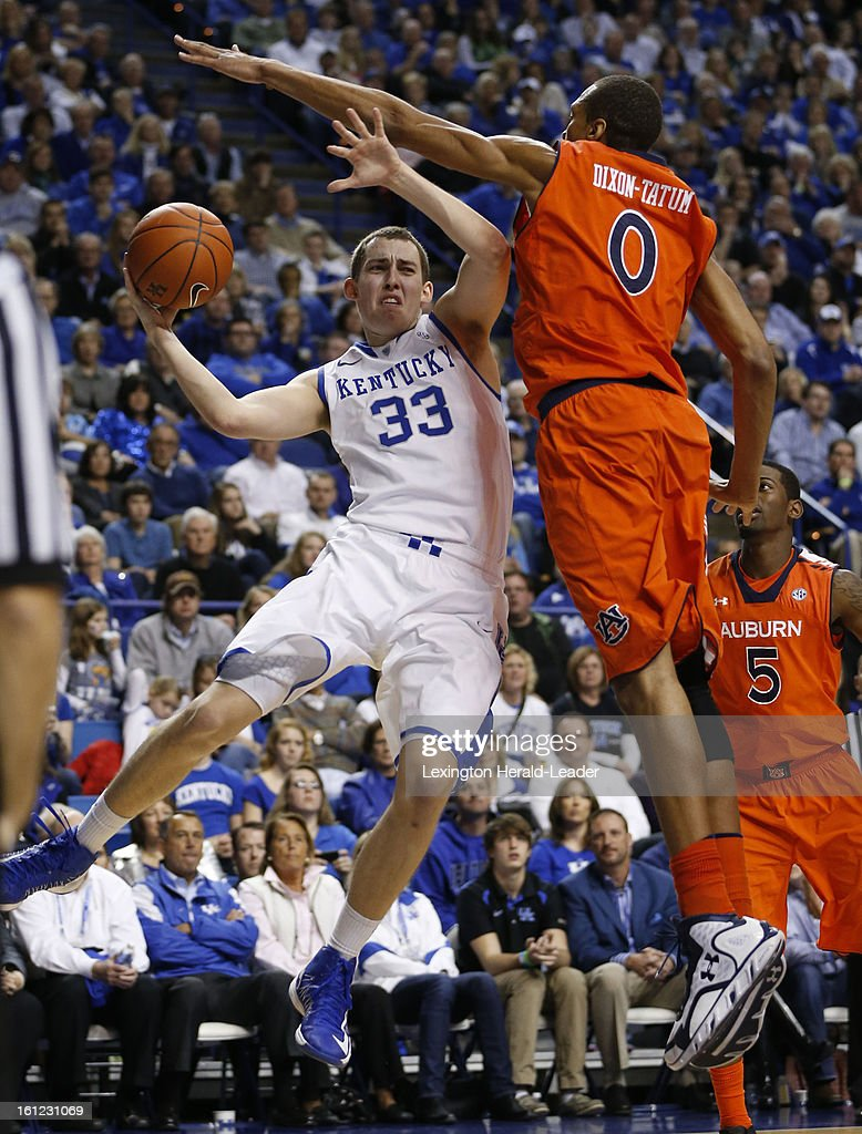 Kentucky's Kyle Wiltjer (33) is caught in the air trying to make a pass around Auburn's Asauhn Dixon-Tatum (0) at Rupp Arena on Saturday, February 9, 2013, in Lexington, Kentucky. The host Wildcats defeated Auburn, 72-62.