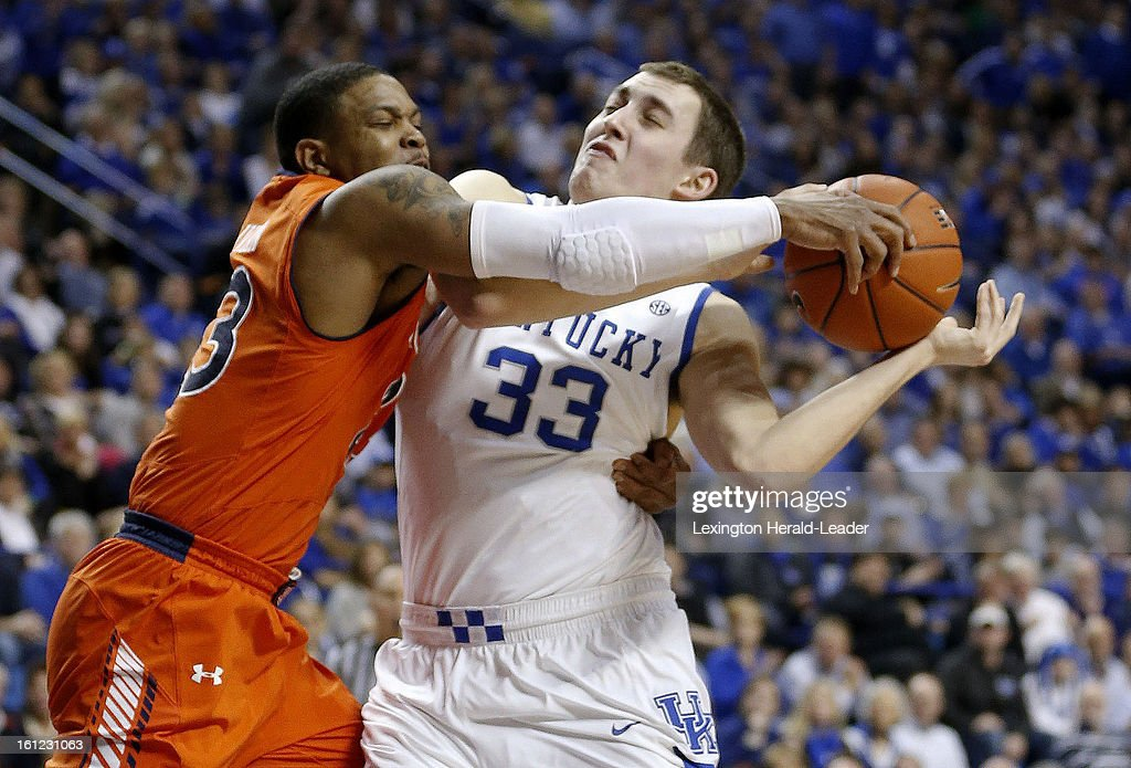 Kentucky's Kyle Wiltjer (33) is fouled by Auburn's Frankie Sullivan at Rupp Arena on Saturday, February 9, 2013, in Lexington, Kentucky. The host Wildcats defeated Auburn, 72-62.