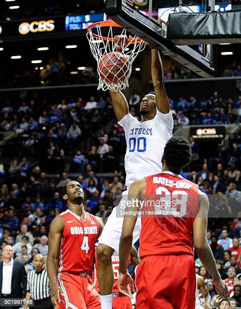 Kentucky's Marcus Lee takes an Isaiah Briscoe pass in for a dunk against Ohio State's Daniel Giddens and Keita BatesDiop on Saturday Dec 19 at the...