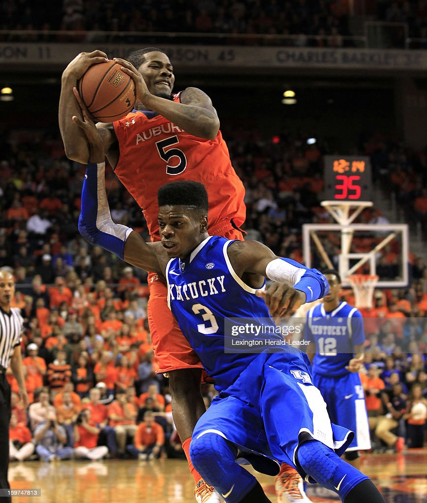 Kentucky's Nerlens Noel (3) battles Auburn's Shaquille Johnson (5) for a loose ball at Auburn Arena in Auburn, Alabama, on Saturday, January 19, 2013. Kentucky won, 75-53.