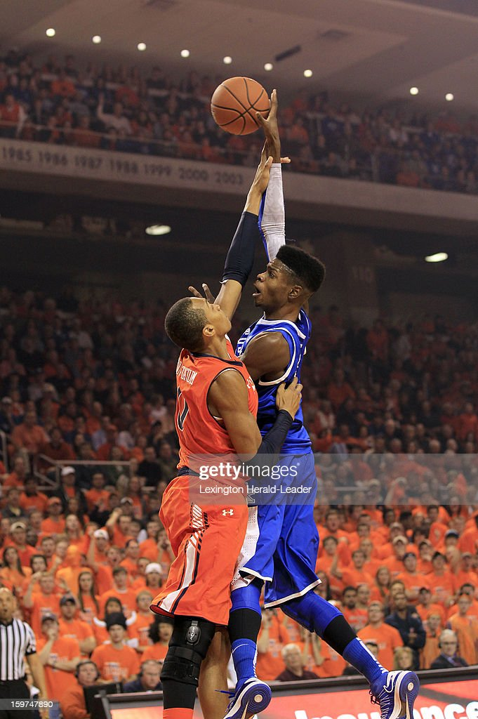 Kentucky's Nerlens Noel (3) scores despite the defensive work of Auburn's Asauhn Dixon-Tatum at Auburn Arena in Auburn, Alabama, on Saturday, January 19, 2013. Kentucky won, 75-53.
