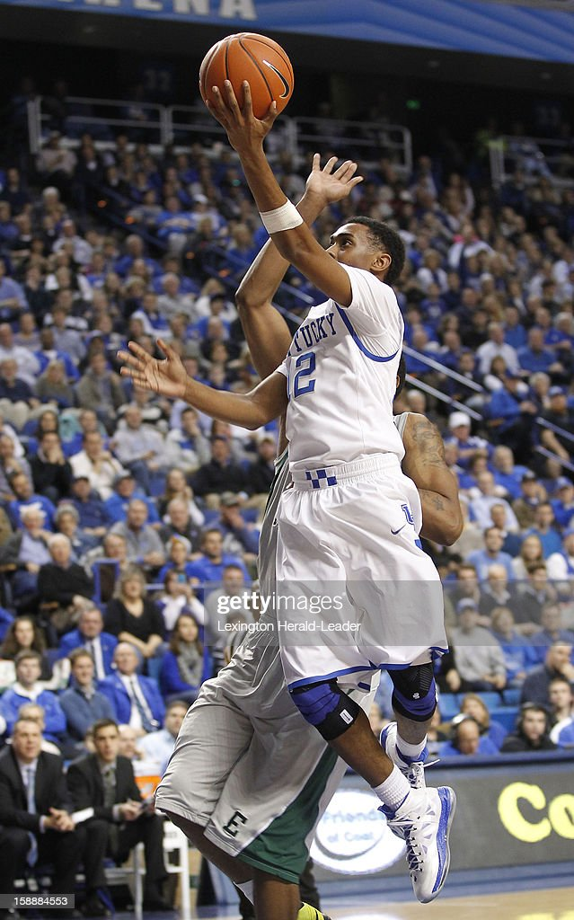 Kentucky's Ryan Harrow (12) drives in for a first-half layup against Eastern Michigan at Rupp Arena in Lexington, Kentucky, on Wednesday, January 2, 2013. Kentucky routed the visiting Eagles, 90-38.