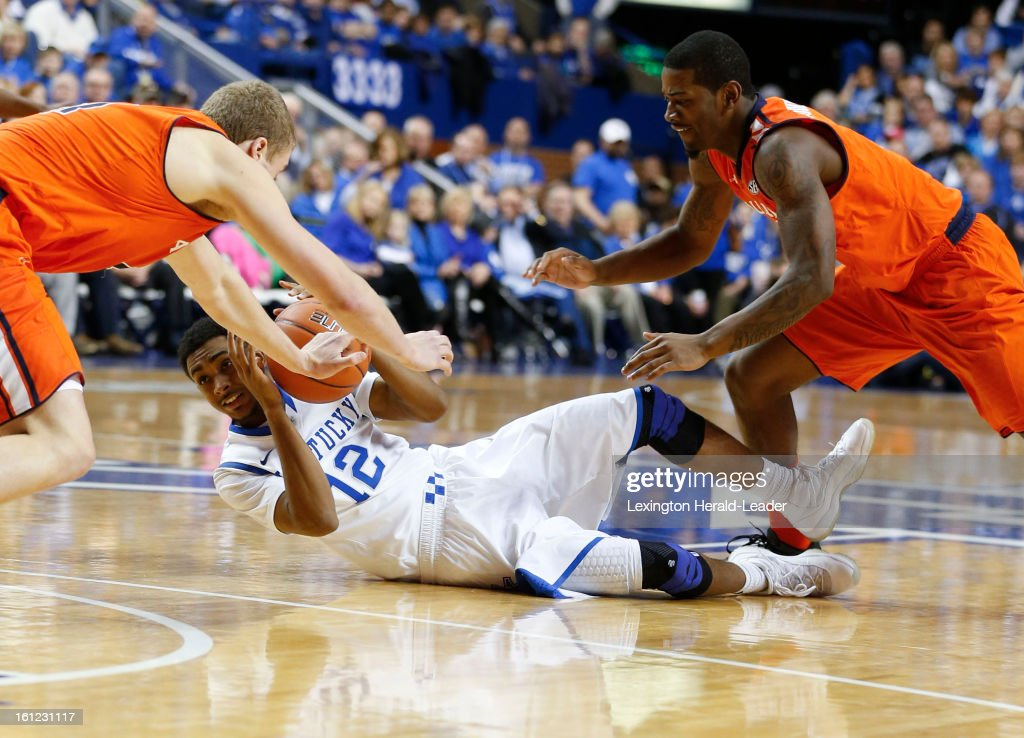 Kentucky's Ryan Harrow (12) looks for help as Auburn's Rob Chubb, left, and Shaquille Johnson close in at Rupp Arena on Saturday, February 9, 2013, in Lexington, Kentucky. The host Wildcats defeated Auburn, 72-62.