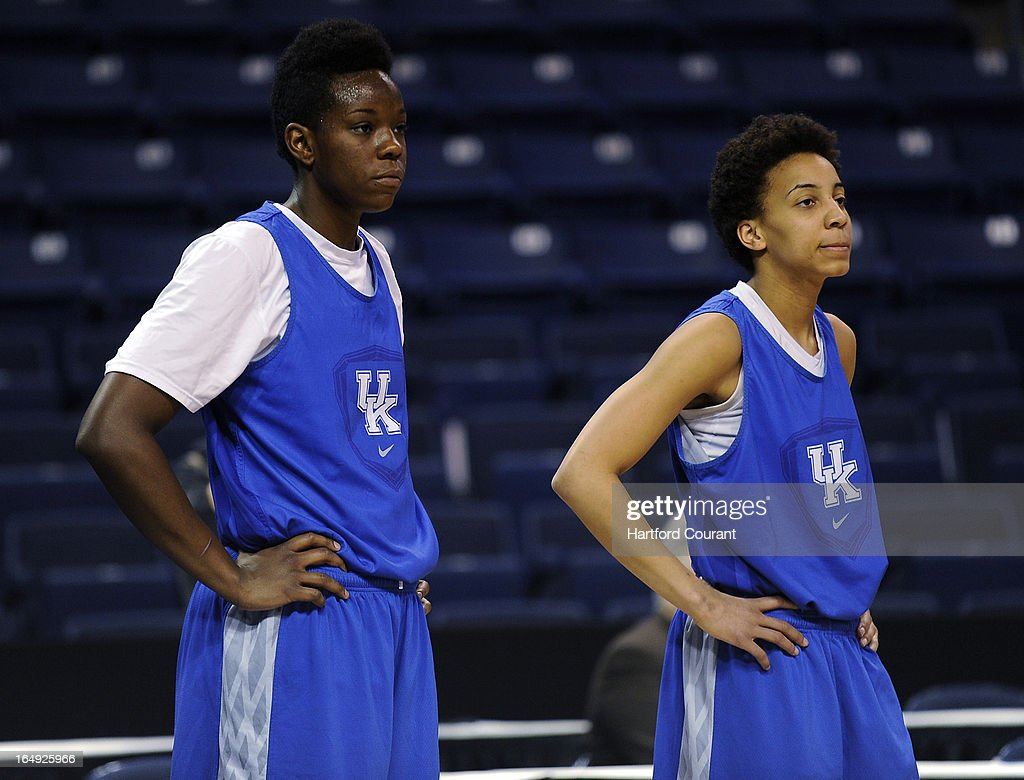 Kentucky's Samarie Walker, left, and Kastine Evans listen as head coach Matthew Mitchell gives instruction during practice at the TD Bank Arena at Harbor Yard in Bridgeport, Connecticut, Friday, March 29, 2013.