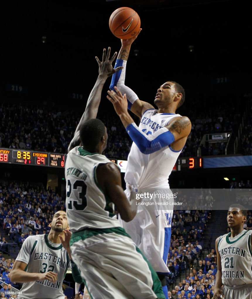 Kentucky's Willie Cauley-Stein (15) scores over Eastern Michigan's Glenn Bryant (23) at Rupp Arena in Lexington, Kentucky, on Wednesday, January 2, 2013. Kentucky routed the visiting Eagles, 90-38.