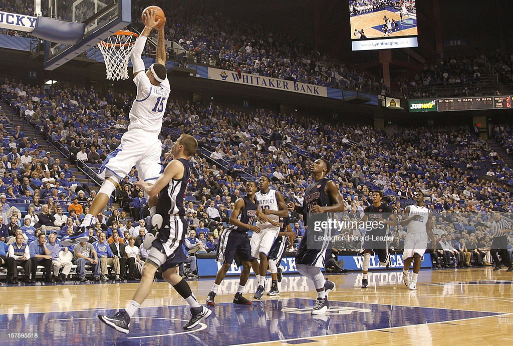 Kentucky's Willie Cauley-Stein (15) throws down an alley-oop pass aginst Samford at Rupp Arena on Tuesday, December 4, 2012, in Lexington, Kentucky. Kentucky defeated Samford 88-56.