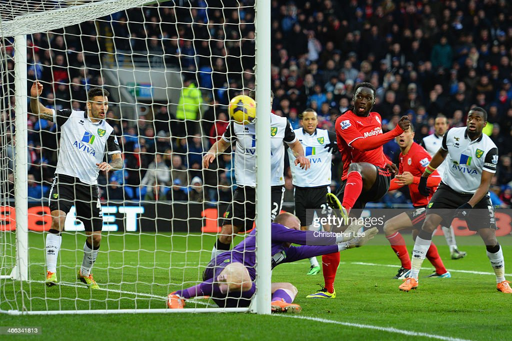 <a gi-track='captionPersonalityLinkClicked' href=/galleries/search?phrase=Kenwyne+Jones&family=editorial&specificpeople=553966 ng-click='$event.stopPropagation()'>Kenwyne Jones</a> of Cardiff City beats goalkeeper <a gi-track='captionPersonalityLinkClicked' href=/galleries/search?phrase=John+Ruddy&family=editorial&specificpeople=822348 ng-click='$event.stopPropagation()'>John Ruddy</a> of Norwich City to score their second goal during the Barclays Premier League match between Cardiff City and Norwich City at Cardiff City Stadium on February 1, 2014 in Cardiff, Wales.