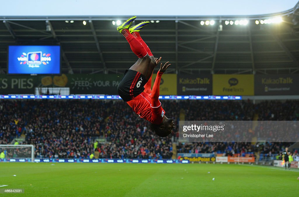 <a gi-track='captionPersonalityLinkClicked' href=/galleries/search?phrase=Kenwyne+Jones&family=editorial&specificpeople=553966 ng-click='$event.stopPropagation()'>Kenwyne Jones</a> of Cardiff City celebrates with a somersault as he scores their second goal during the Barclays Premier League match between Cardiff City and Norwich City at Cardiff City Stadium on February 1, 2014 in Cardiff, Wales.