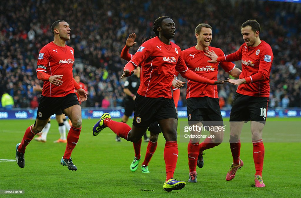 <a gi-track='captionPersonalityLinkClicked' href=/galleries/search?phrase=Kenwyne+Jones&family=editorial&specificpeople=553966 ng-click='$event.stopPropagation()'>Kenwyne Jones</a> of Cardiff City (C) celebrates with team mates as he scores their second goal during the Barclays Premier League match between Cardiff City and Norwich City at Cardiff City Stadium on February 1, 2014 in Cardiff, Wales.