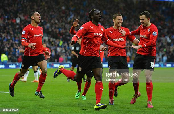 Kenwyne Jones of Cardiff City celebrates with team mates as he scores their second goal during the Barclays Premier League match between Cardiff City...