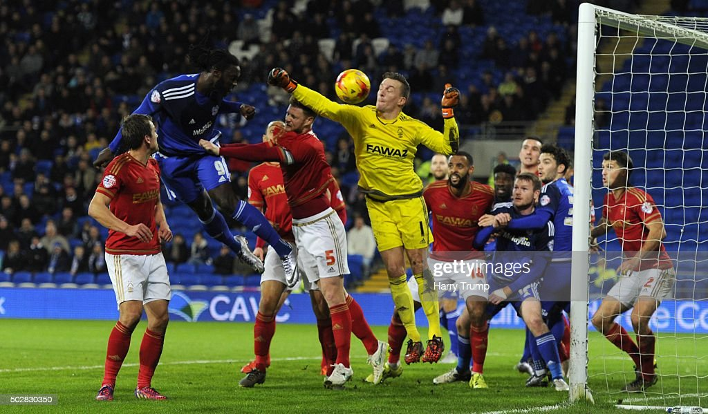 Kenwyne Jones of Cardiff City(L) heads just wide during the Sky Bet Championship match between Cardiff City and Nottingham Forest at the Cardiff City Stadium on December 29, 2015 in Cardiff, Wales.