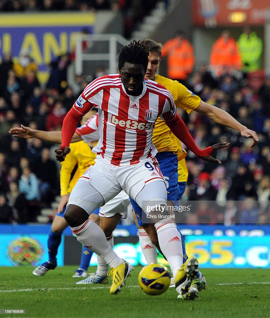 <a gi-track='captionPersonalityLinkClicked' href=/galleries/search?phrase=Kenwyne+Jones&family=editorial&specificpeople=553966 ng-click='$event.stopPropagation()'>Kenwyne Jones</a> of Stoke City scores his side's first goal during the Barclays Premier League match between Stoke City and Southampton at Britannia Stadium on December 29, 2012 in Stoke on Trent, England.