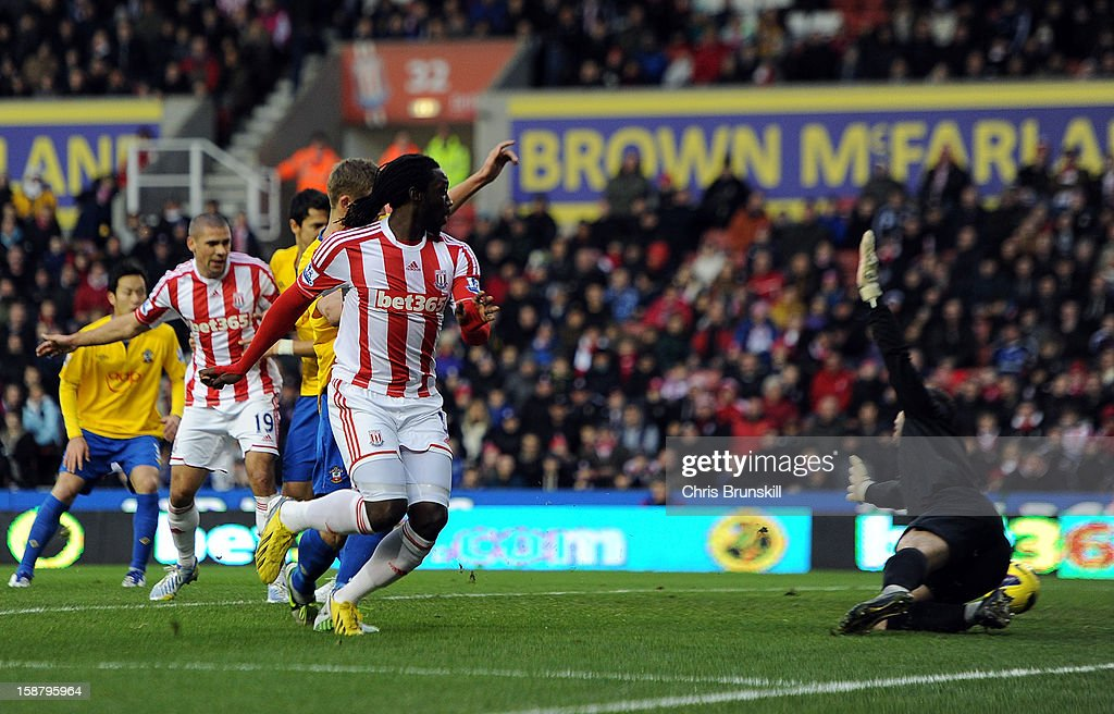 Kenwyne Jones (L) of Stoke City scores their first goal past Kelvin Davis (R) of Southampton during the Barclays Premier League match between Stoke City and Southampton at Britannia Stadium on December 29, 2012 in Stoke on Trent, England.