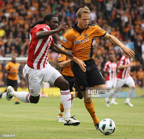 Kenwyne Jones of Stoke City tries to tackle Christophe Berra of Wolverhampton Wanderers during the Barclays Premier League match between...