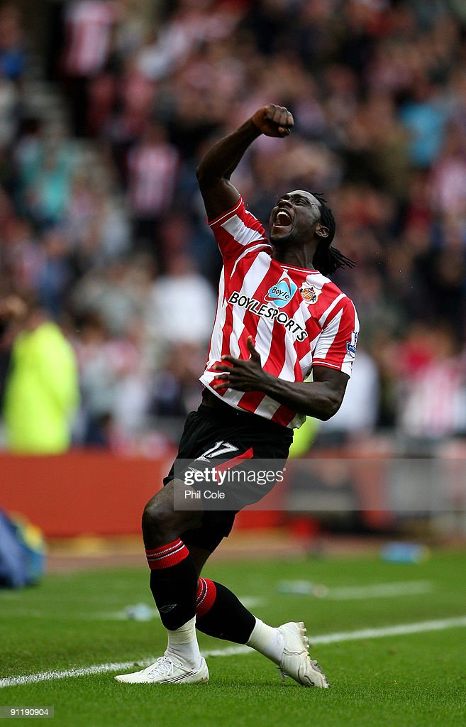 <a gi-track='captionPersonalityLinkClicked' href=/galleries/search?phrase=Kenwyne+Jones&family=editorial&specificpeople=553966 ng-click='$event.stopPropagation()'>Kenwyne Jones</a> of Sunderland celebrates after scoring during the Barclays Premier League match between Sunderland and Wolverhampton Wanderers at the Stadium of Light on September 27, 2009 in Sunderland, England.