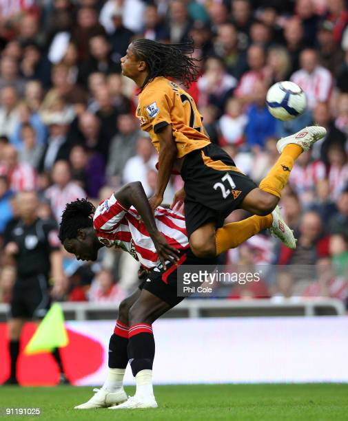 Kenwyne Jones of Sunderland is tackled by Michael Mancienne of Wolverhampton Wanderers during the Barclays Premier League match between Sunderland...