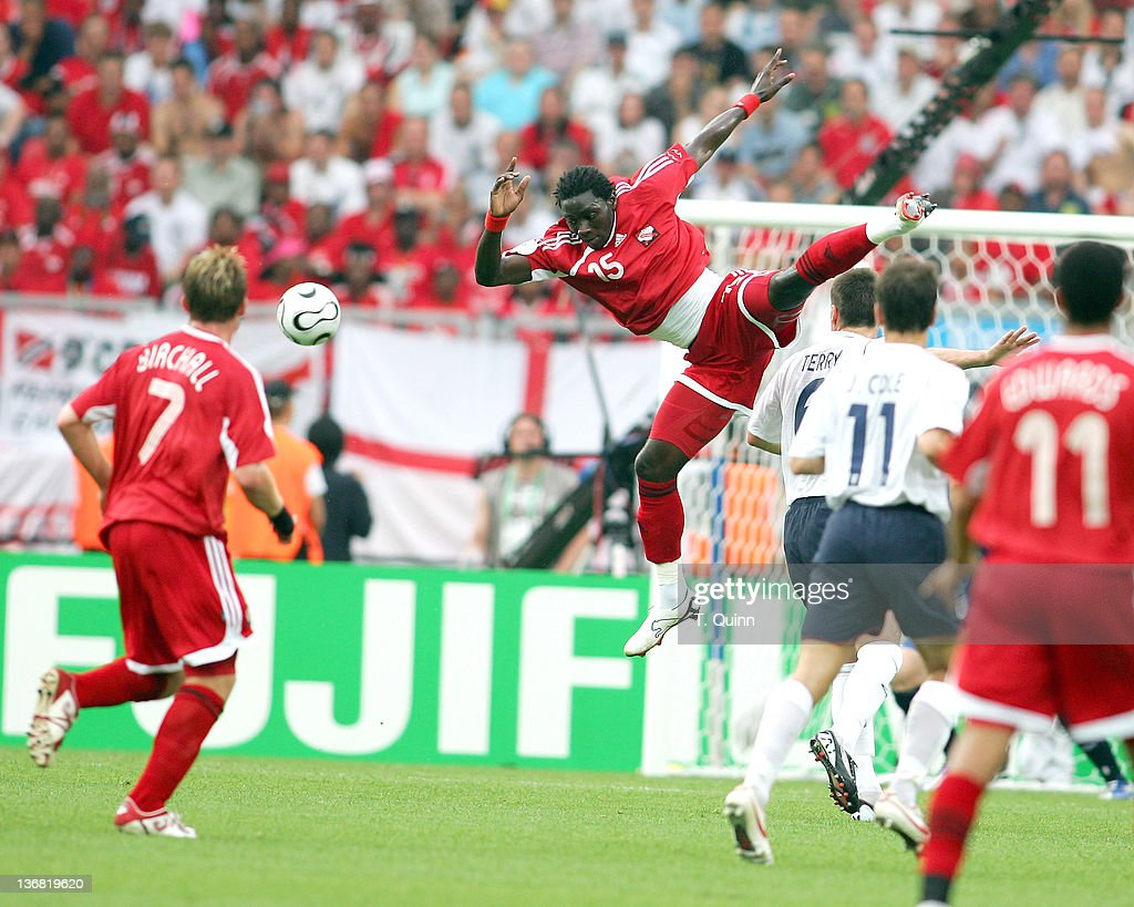 <a gi-track='captionPersonalityLinkClicked' href=/galleries/search?phrase=Kenwyne+Jones&family=editorial&specificpeople=553966 ng-click='$event.stopPropagation()'>Kenwyne Jones</a> of Trinidad and Tobago flies through the air after crashing into <a gi-track='captionPersonalityLinkClicked' href=/galleries/search?phrase=John+Terry&family=editorial&specificpeople=171535 ng-click='$event.stopPropagation()'>John Terry</a> of England during the Group B match in Nuremberg, Germany on June 15, 2006. England defeated Trinidad with two late goals.