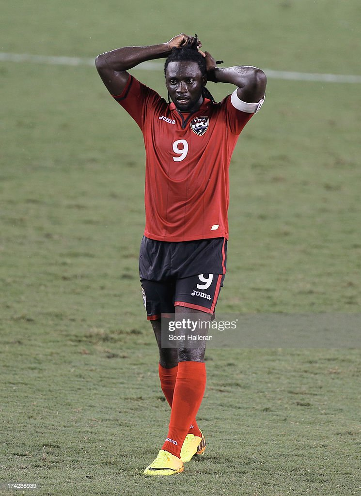 <a gi-track='captionPersonalityLinkClicked' href=/galleries/search?phrase=Kenwyne+Jones&family=editorial&specificpeople=553966 ng-click='$event.stopPropagation()'>Kenwyne Jones</a> #9 of Trinidad & Tobago waits on the field against Honduras during the CONCACAF Gold Cup game at BBVA Compass Stadium on July 15, 2013 in Houston, Texas.