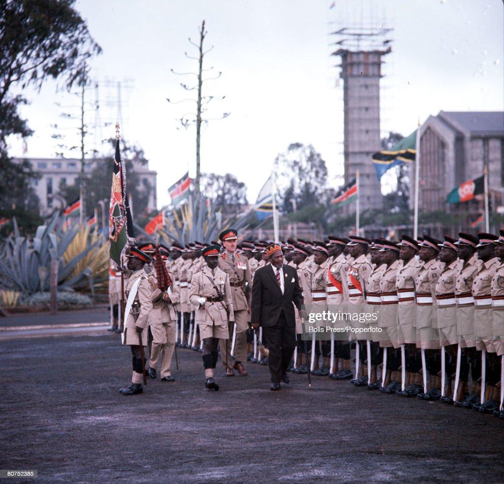 1963, Kenya, Africa, Kenya Independence Ceremonies, President Jomo Kenyatta is pictured inspecting a Guard of Honour