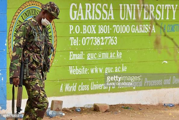 A Kenya Defence forces soldier walks past the front entrance of Moi University Garissa on April 3 2015 Kenya's interior minister vowed that the...